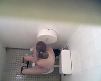 Spy clip from a swimming pool water closet - chick takes a piddle