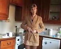 Lusty blond older hotwife Sara shows off her goodies in kitchen