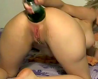 Hussy wife beads her stretched chocolate hole on champagne bottle