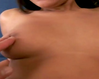 Svelte brunette cutie positions for the camera rubbing her beefy vagina
