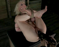 Dominant bastard uses dildos to polish holes of bound up golden-haired nympho