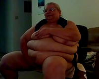 Extremely obese older golden-haired white lady sucks a sextoy on the livecam