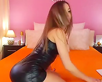 Alluring lengthy haired web camera sweetheart in dark taut suit and high heels went solo