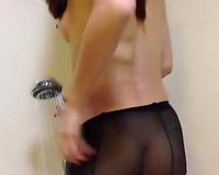 Slutty Chinese dirty slut wife taking shower in nylon hose