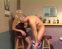 Mature golden-haired doxy in stockings sucks and copulates doggy position like a pro