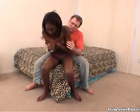 Ebony skinny young playgirl in the bedroom with a white chap