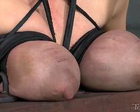 Busty useless white slut bound to the wooden BDSM throne