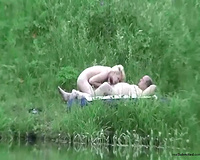 Skinny skank with her bulky older fuck buddy by the lake