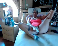 Rocking zesty and thick cougar in pink costume pleases herself with Hitachi