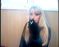 Blonde sexy doxy smokes on web camera to tease me and puff smoke in my face