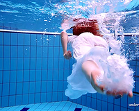 Cute and hawt Russian redhead legal age teenager filmed undressed in the pool underwater