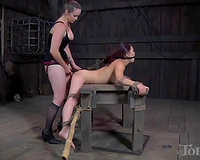 Beautiful narrow eyed Asian BDSM thrall fastened and hooked