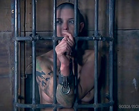 Metal thong shackles for her neck and hands to freak her out