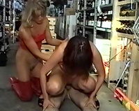 Two wicked German strumpets in the store riding on a cock on the floor