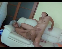 Slutty old nanny shares double ended sex-toy with youthful girlfriend