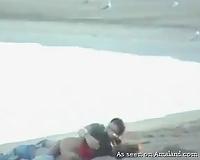 Horny Spanish pair having quick sex on the public beach