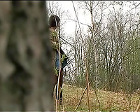 Adorable non-professional brunette hair white lady in the woods pissing behind the tree