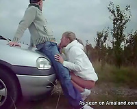 Kinky pair having sex outdoors near the car