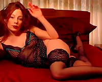 Kinky red haired wife in dark lacy underware showed off her bum
