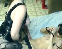 Skinny brunette hair lets a lesbo fuck her cunt with a ding-dong