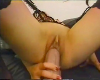 Dirty Asian bitch in stockings rides huge fake pecker greedily