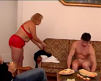 Playful non-professional blonde big beautiful woman playgirl on the sofa eagerly blows penis of a dude