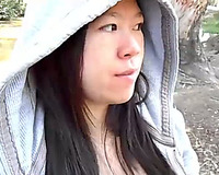 Asian beauty blowing chunky jock outside