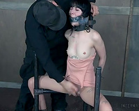 Brunette slim housewife restrained and duct taped for silence