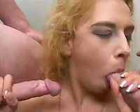 Trashy blond whore sucks 2 hard rods in MMF three-some foreplay