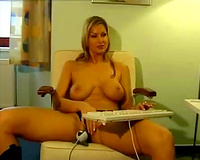 Torrid neighbour blondie works on computor and copulates her wet crack with toy