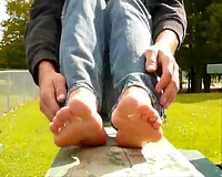 Lovely girlfriend teases me with her charming filthy feet on bench in park