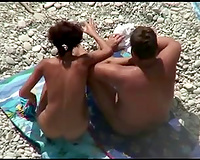 I spy on a perverted non-professional tanned brunette hair engulfing her man's 10-Pounder on beach