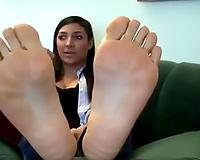 Lovely latin chick brunette honey shows her smooth soles on webcam