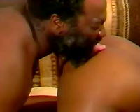 Chunky dark milf playgirl rides a buff dark fellow on the daybed