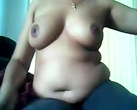 Chubby dilettante Desi fatso brags of her large boobies in front of webcam