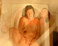 My dirty-minded black haired girlfriend masturbated in the baths tub