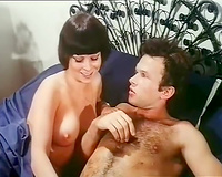 Beautiful brunette playgirl gives head to her paramour in arousing retro sex episode