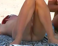 Nudist white lady was sunbathing and flashing her unattractive natural love bubbles on the beach