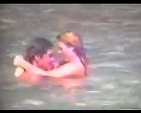 Sexy pair of blonde people getting horny and cuddly on the beach