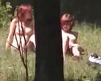 I spied and filmed two nudist babes in the woods all stripped sunbathing