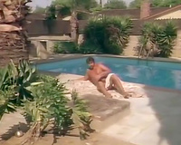 Two sexy blondes are having enjoyment with this moustached chap by the pool