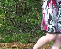 Redhead Russian youthful hottie in costume flashes her shaggy vagina in the woods