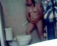 My concupiscent overweight dark brown wife masturbates her fur pie on the latrine bowl