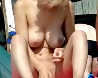 Spying one bare white wife rubbing against her spouse on the beach