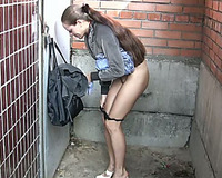 Redhead authentic Russian slutwife makes water on the crowded street