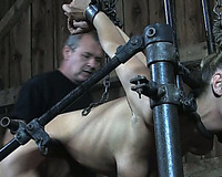 Slender white slut restrained on the pipes and drooled