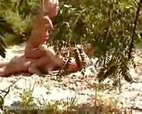 Beautiful bare floozy rides her mate on the beach - spy movie scene