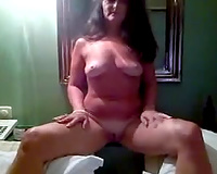 My aunt sits nude in her room and rubs her moist itchy bawdy cleft on camera