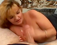 Nice engulfing and jerking off from a golden-haired milf for facial spunk flow