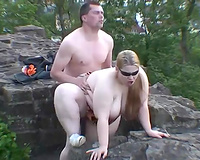 Shagging BBW floozy in a doggy position in the nature